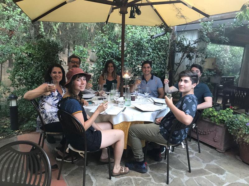 Aldo Cundari Family Enjoying Meal On Veranda