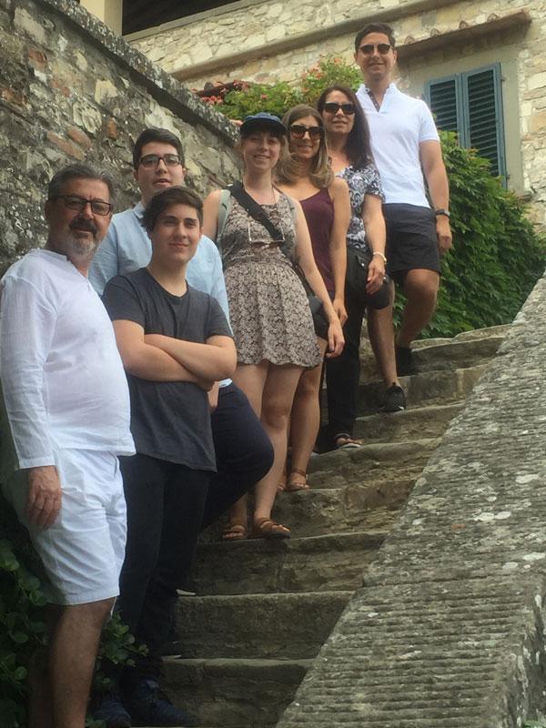 Aldo Cundari Family Posing For Photo On Steps In Tuscany Italy