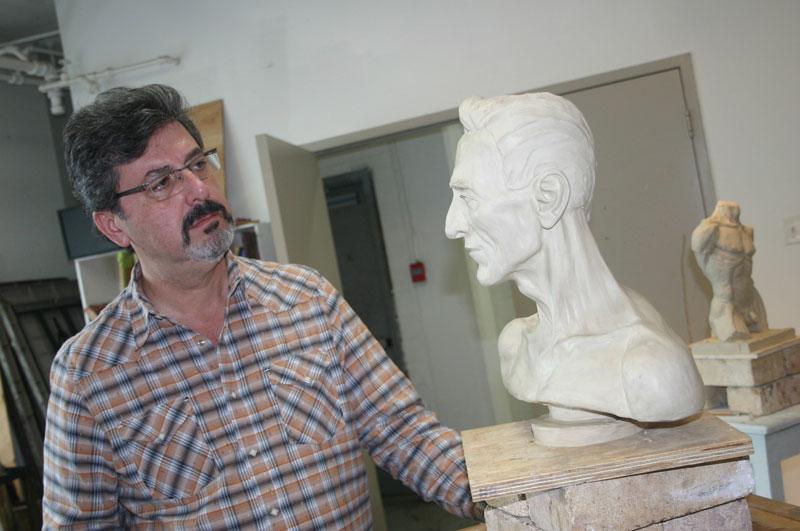 Aldo Cundari In His Art Studio Looking At Sculpture