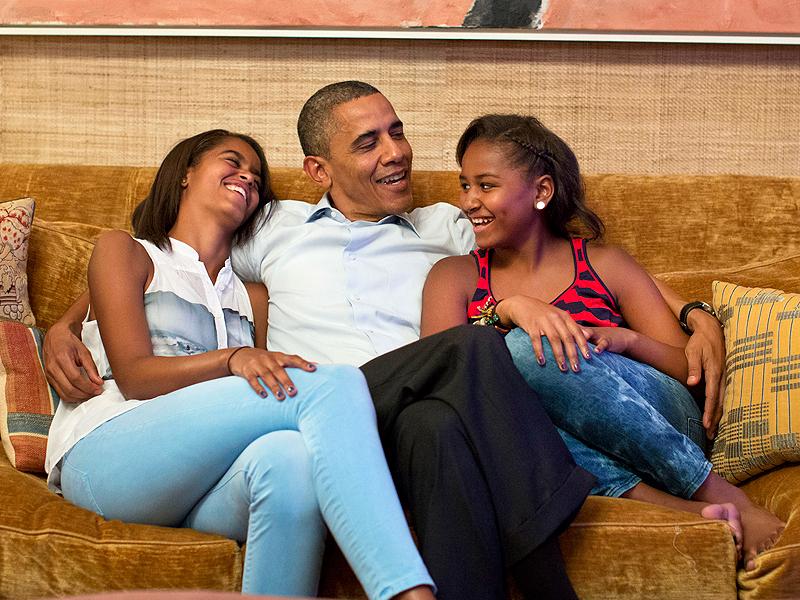 Barack Obama On Sofa With Daughters Malia And Sasha