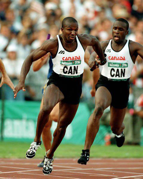 Bruny Surin Passing 4 x 400 Meter Team Race Batton To Donovan Baily At 1988 Olympics In Atlanta