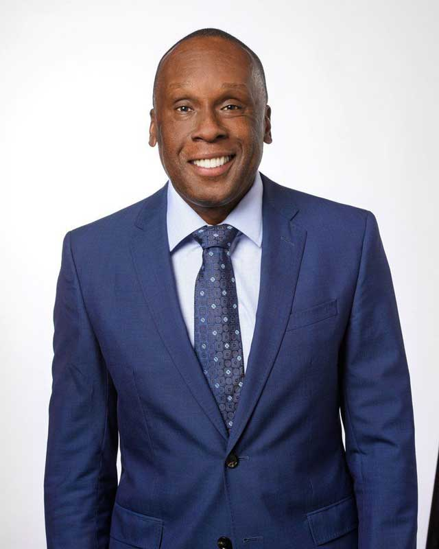 Bruny Surin Corporate Photo in Business Suit
