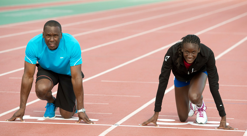 Bruny Surin Kneeling At Starting Line Of Track Course With Daughter Kat Surin