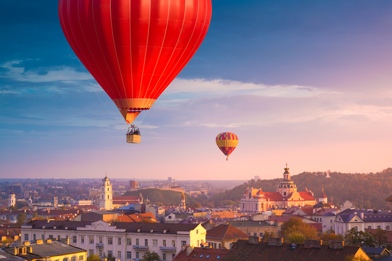 Hot Air Balloons Over The Old Town Center of Vilnius Lithuania