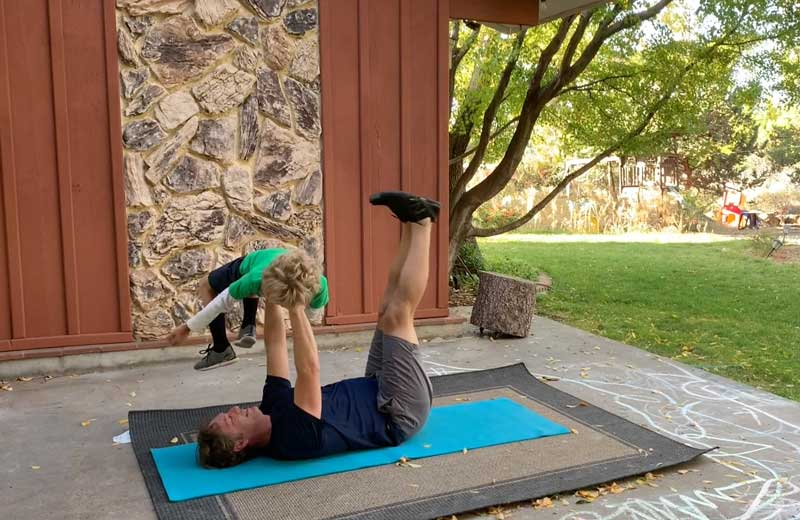 Sorren Harrison Of Fit Daddy 365 Doing 5 Lying Leg Lifts With Son