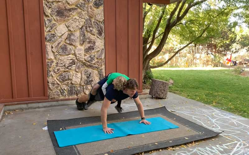 Sorren Harrison of Fit Daddy 365 Doing 5 Push-Ups With Son On His Back