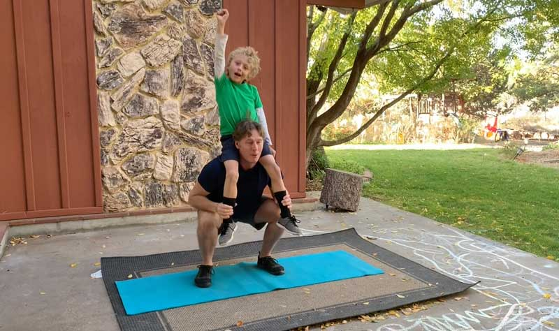 Sorren Harrison Of Fit Daddy 365 Doing 5 Shoulder Style Squats With Son