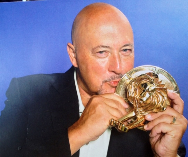 Frank Palmer Holding And Kissing Cannes Lions Advertising Award Trophy