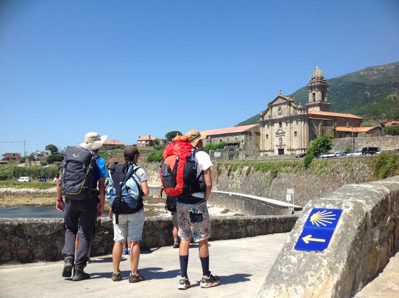 Walking Mentorship Program Backpackers Looking at Church