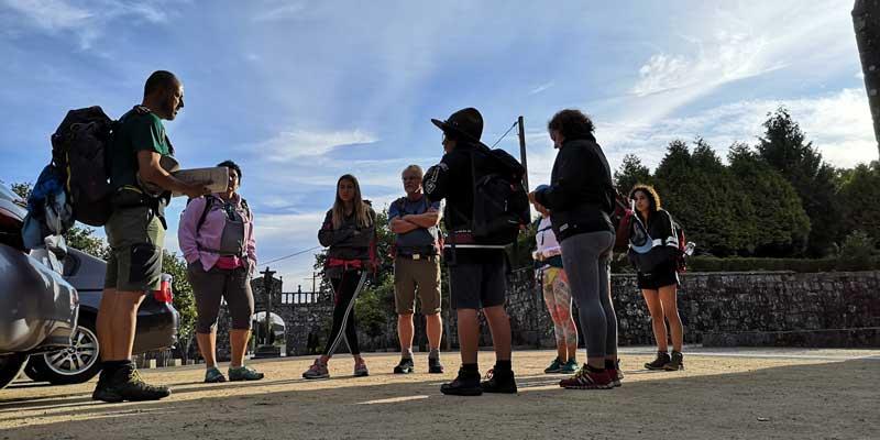 Nuno Santos Fernandes Speaking To Group Of People With Backpacks Before Starting Walk