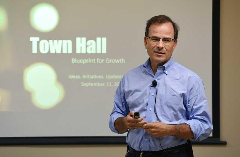 John Boynton Giving A Lecture At A Company Town Hall Meeting