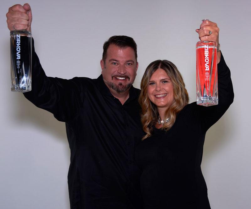 John Vellinga With Wife Katherine Each Holding Up Zirkova Vodka Bottles