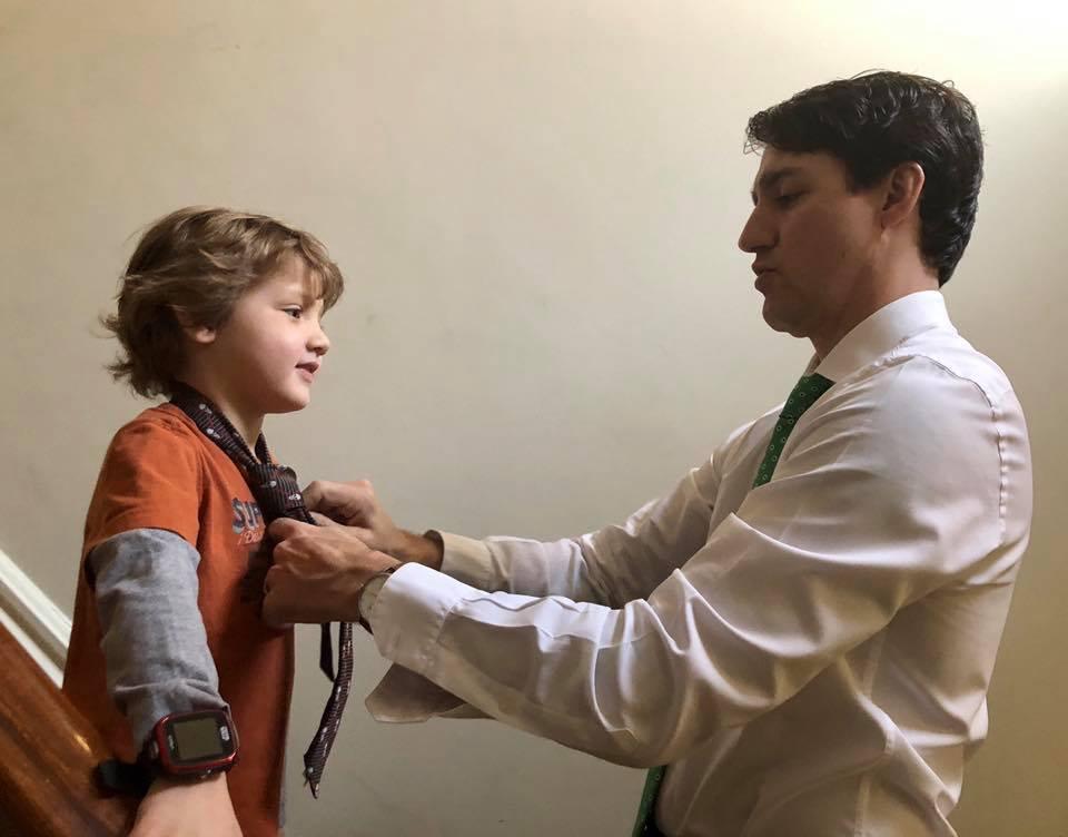 Justin Trudeau Adjusting Tie Of Son Hadrien
