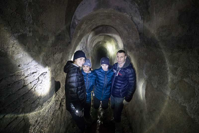 Vitali Klitschko With His Children Discovering Ancient Tunnels Of The Lavra Monastery In Kyiv Ukraine