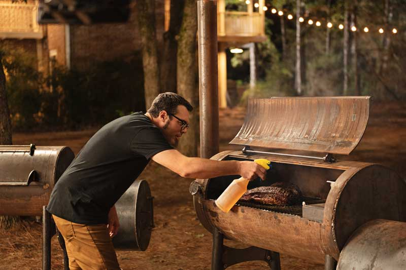 Cheff Aaron Franklin Cooking Meat In A BBQ