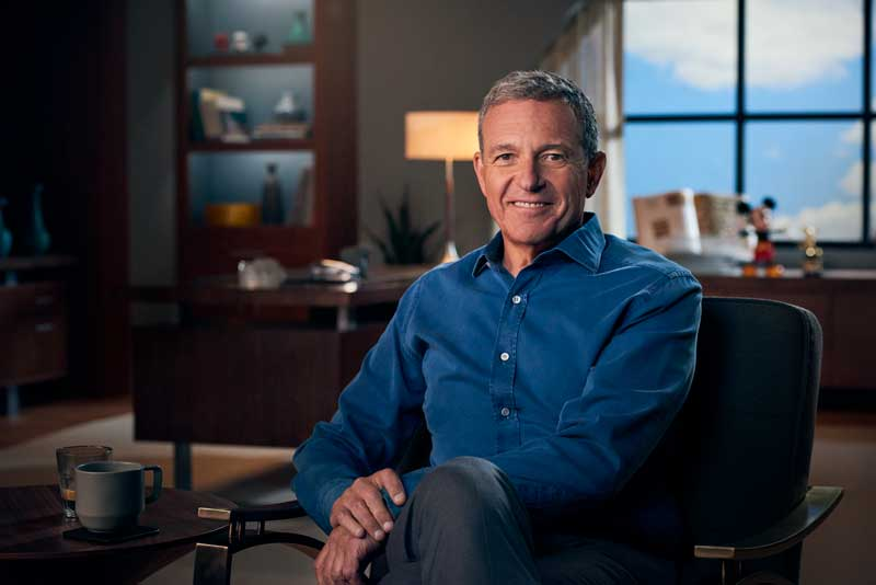 Walt Disney CEO Bob Iger Sitting On Chair in Office Smiling