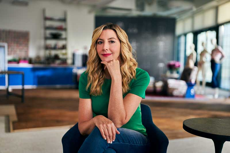 Spanx CEO Sara Blakely Sitting On Chair In Her Office