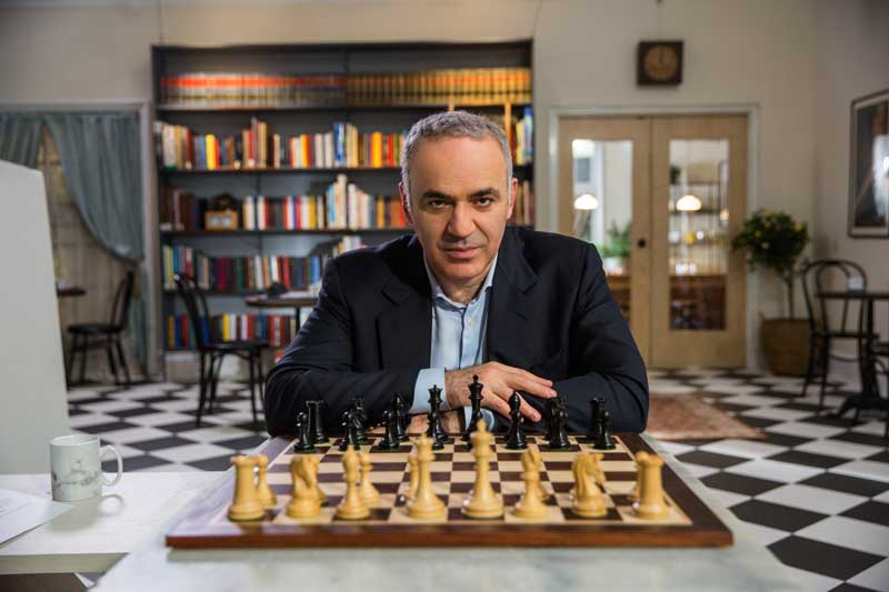 Chess Master Gary Kasparov Sitting In front of Chess Board