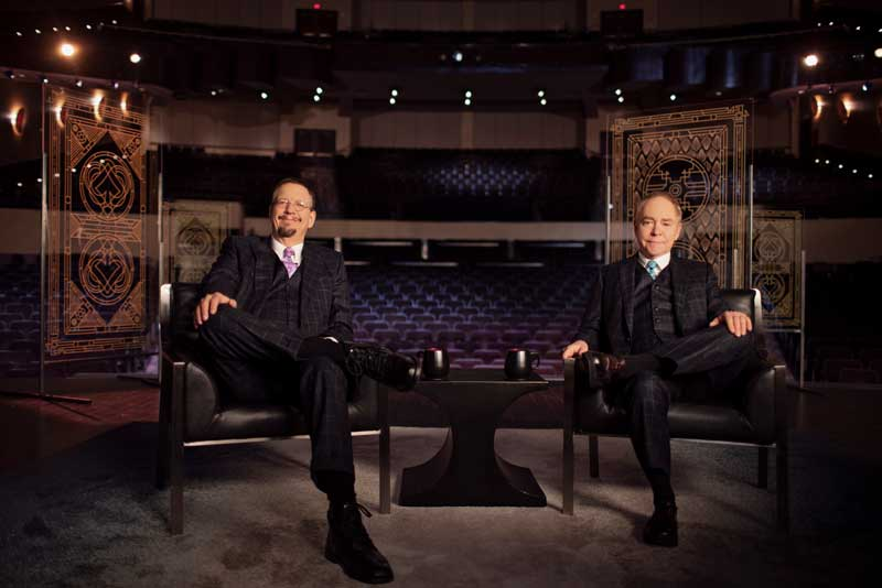 Penn And Teller Sitting On Chairs In Empty Theatre