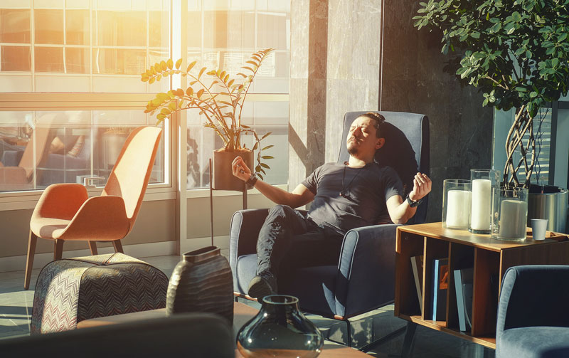 Man Sitting In Office Chair Meditating
