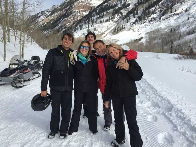 Oscar Munoz And Family With Winter Mountains And Snowmobiles