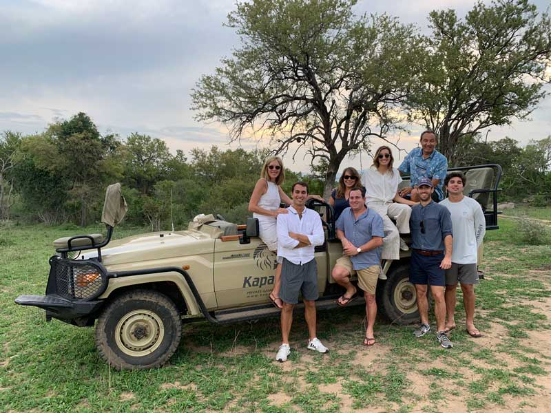 Oscar Munoz And His Family Posing In Front Of 4x4 On Safari In South Africa