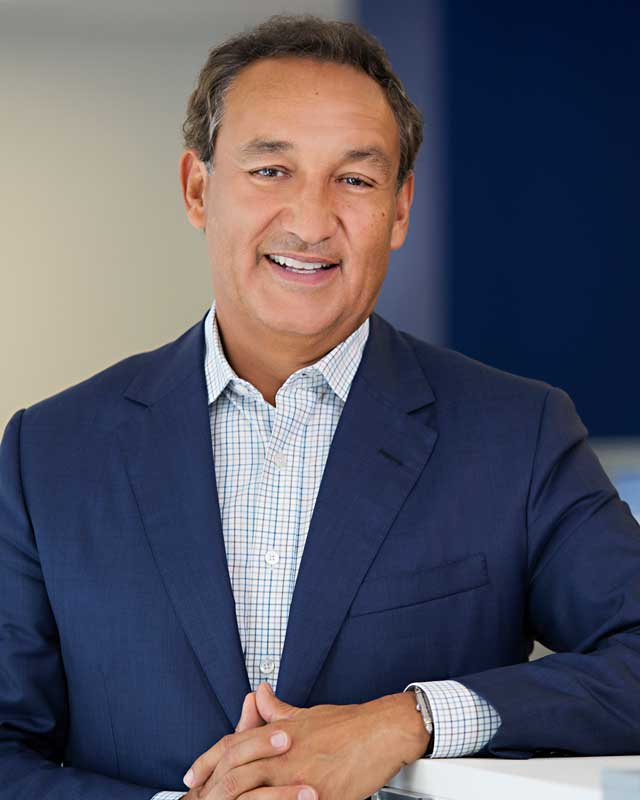 Oscar Munoz In Blue Business Suit Posing For Corporate Photo