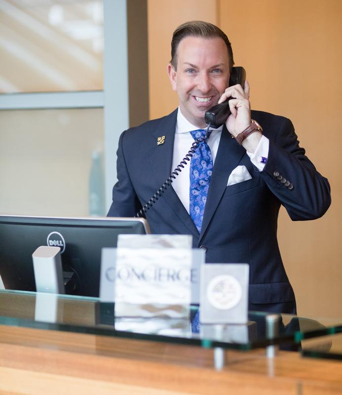 Robert Marks Head Concierge Omni Hotel San Diego Speaking On Telephone
