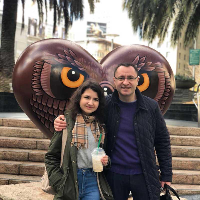 Vasyl Myroshnychenko With Arm Around His Daughter