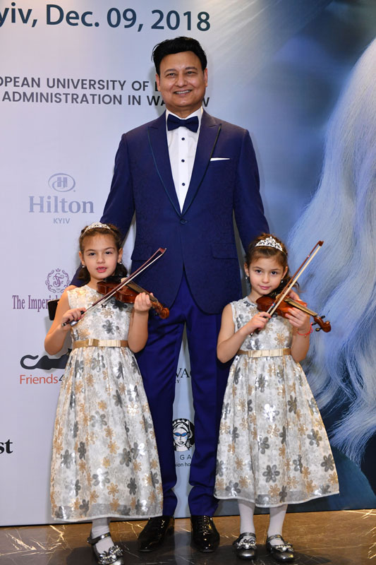 Mohammad Zahoor In Tuxedo With His Twin Daughters Each Holding A Violin