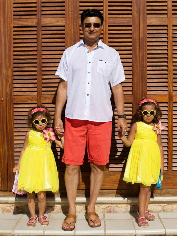 Mohammad Zahoor Holding Hands Of His Twin Daughters