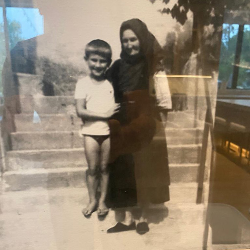 Old Black And White Photo Of Robert Herjavec With His Grand-Mother